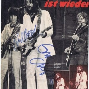 Eric Clapton, Ronnie Wood and Ric Grech autographed magazine